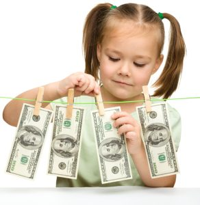 little girl is playing with paper money - dollars,